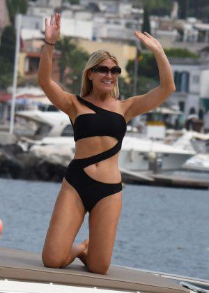 Hofit Golan in Black Bikini on a boat in Ischia