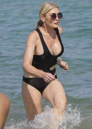 Hofit Golan in Black Swimsuit at the beach in Saint Tropez