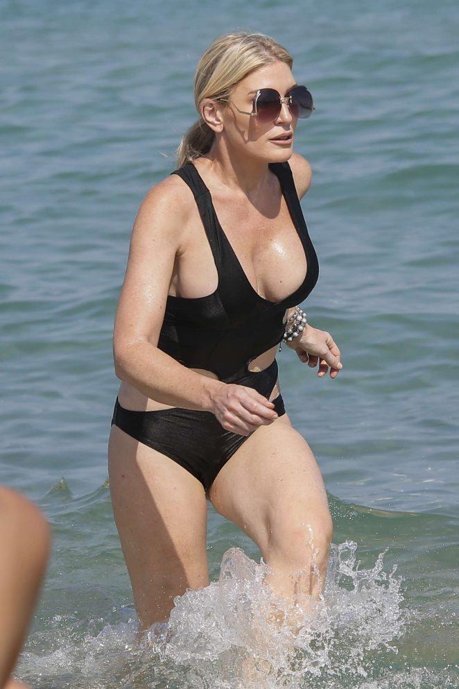Hofit Golan in Black Swimsuit at the beach in Saint Tropez