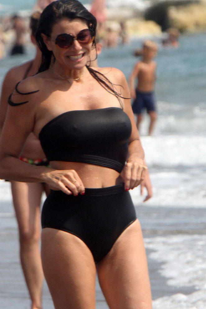 Ilaria D'amico in Black Bikini on the beach in Toscana