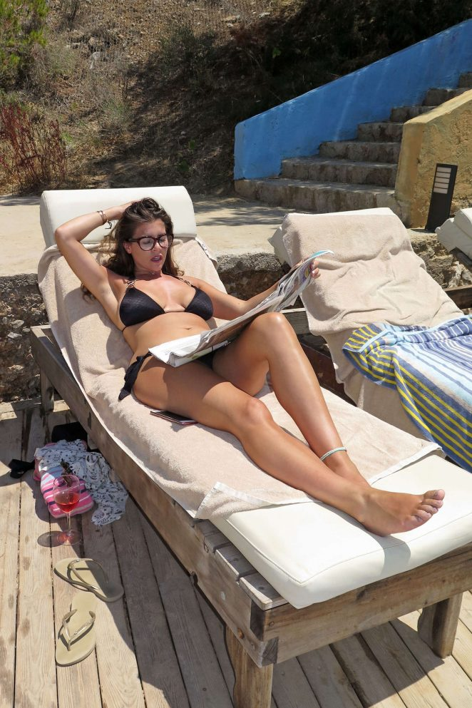 Imogen Thomas in Black Bikini at a pool in Majorca