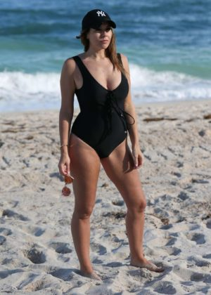 Imogen Thomas in Black Swimsuit at a Beach in Miami