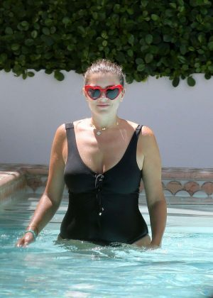 Imogen Thomas in Black Swimsuit on the pool in Miami