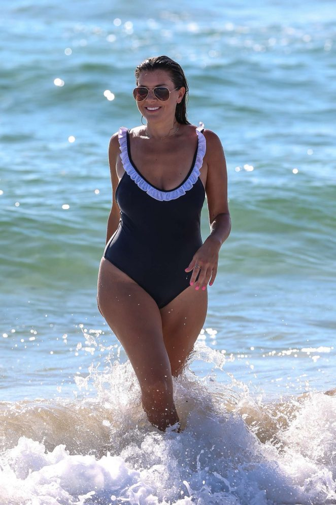 Imogen Thomas in Blue Swimsuit on the beach in Miami