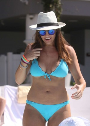 Imogen Thomas in Blue Bikini by the pool in Miami