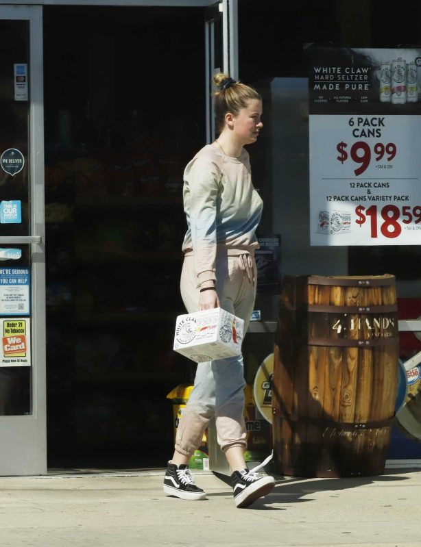 Ireland Baldwin  -Shopping at a liquor store in Los Angeles