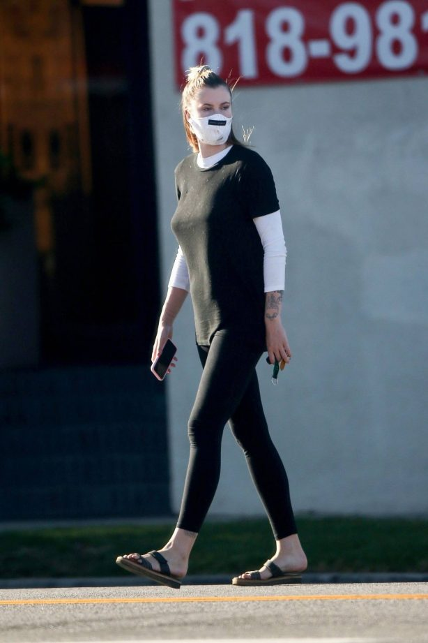 Ireland Baldwin - Wearing mask while run errands in Los Angeles