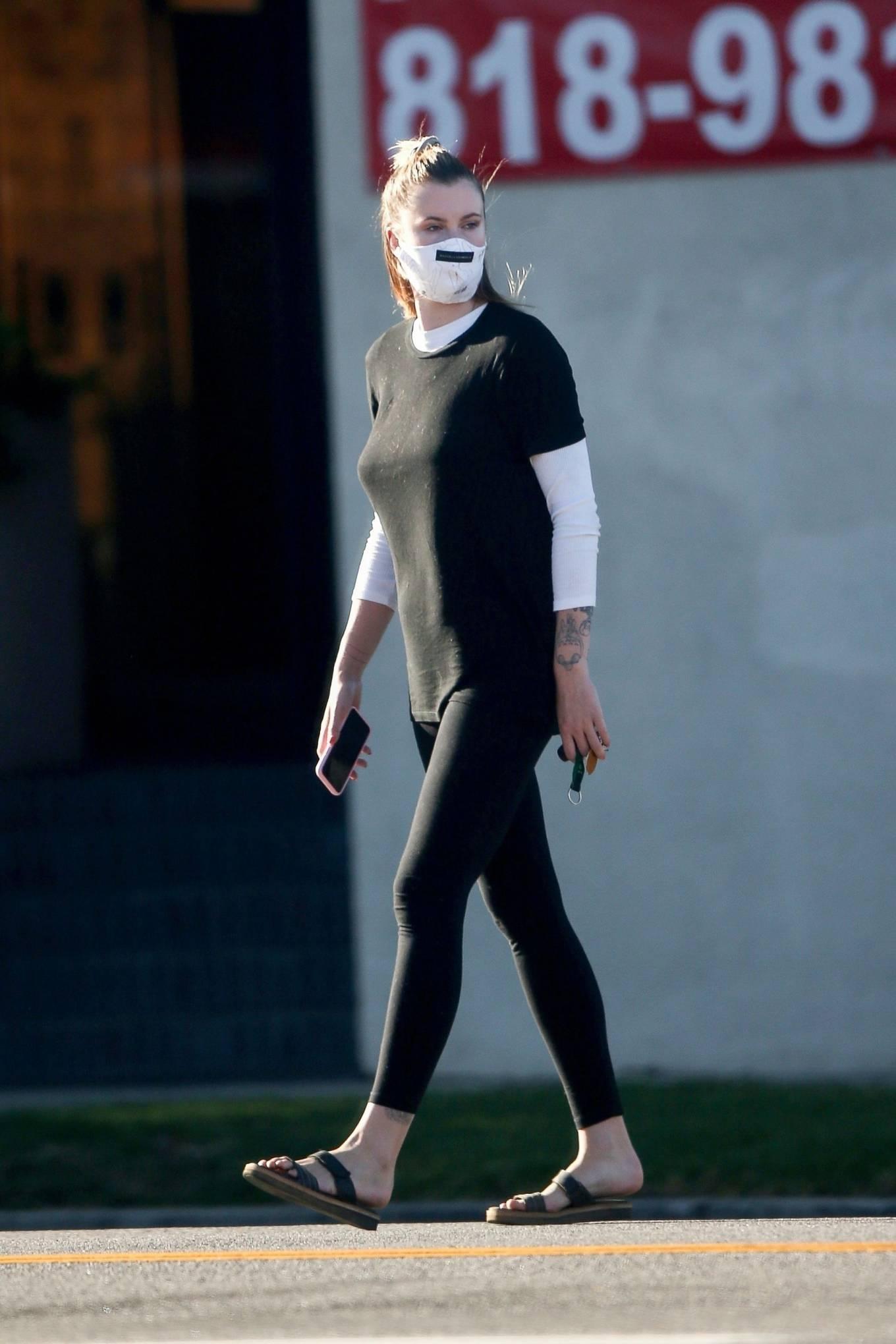 Ireland Baldwin - Wearing mask while run errands in Los Angeles