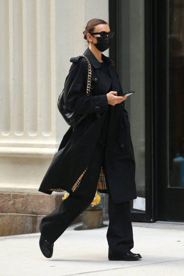 Irina Shayk - In a black Burberry trench coat in New York