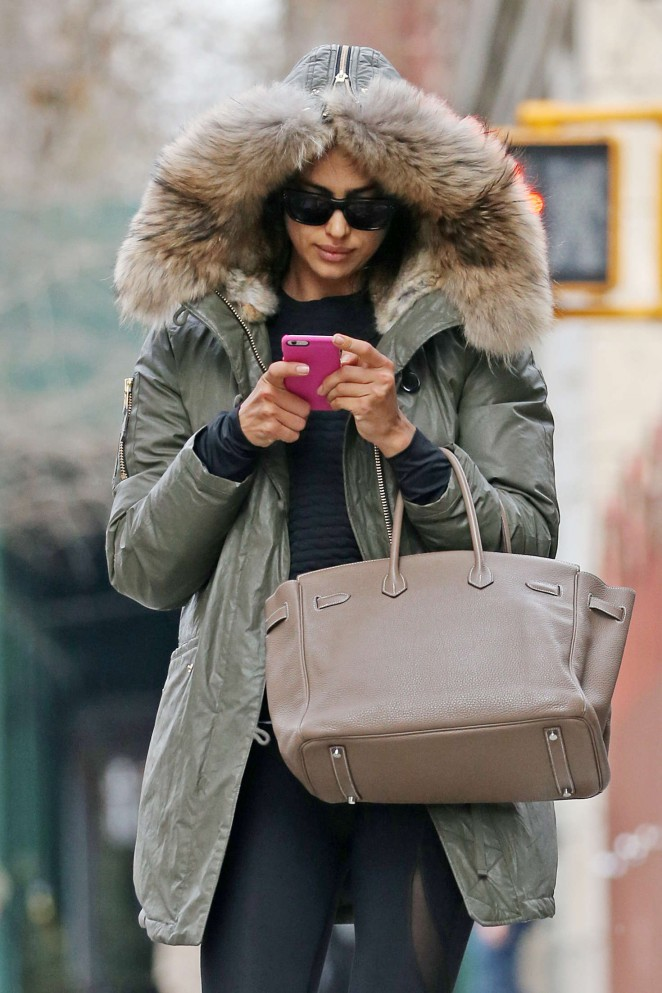 Irina Shayk in a fur hooded jacket in NY