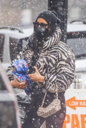 Irina Shayk - In a zebra puffer jacket in New York
