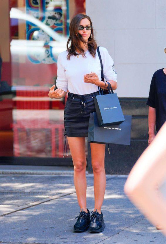 Irina Shayk in Leather Mini Skirt - Shopping in New York