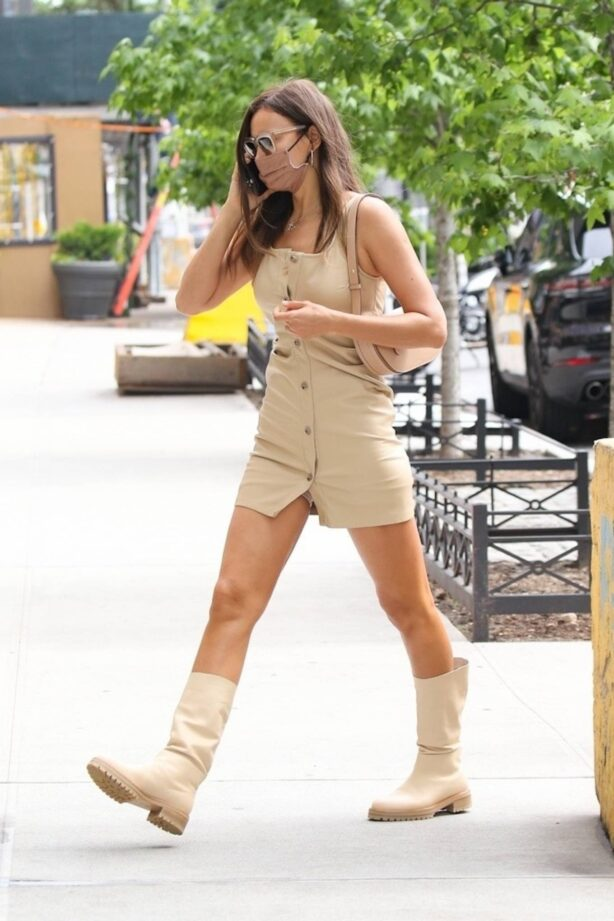 Irina Shayk - Looks stunning in a beige mini dress and boots while out in New York