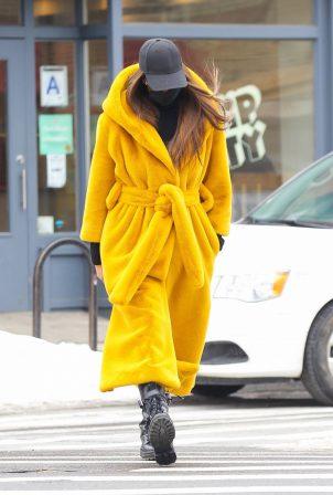 Irina Shayk - Seen in a yellow long puffy coat on a stroll in New York