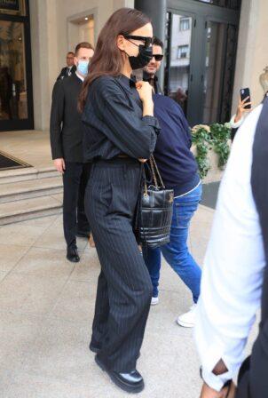 Irina Shayk - Seen wearing pinstriped dress pants in Milan