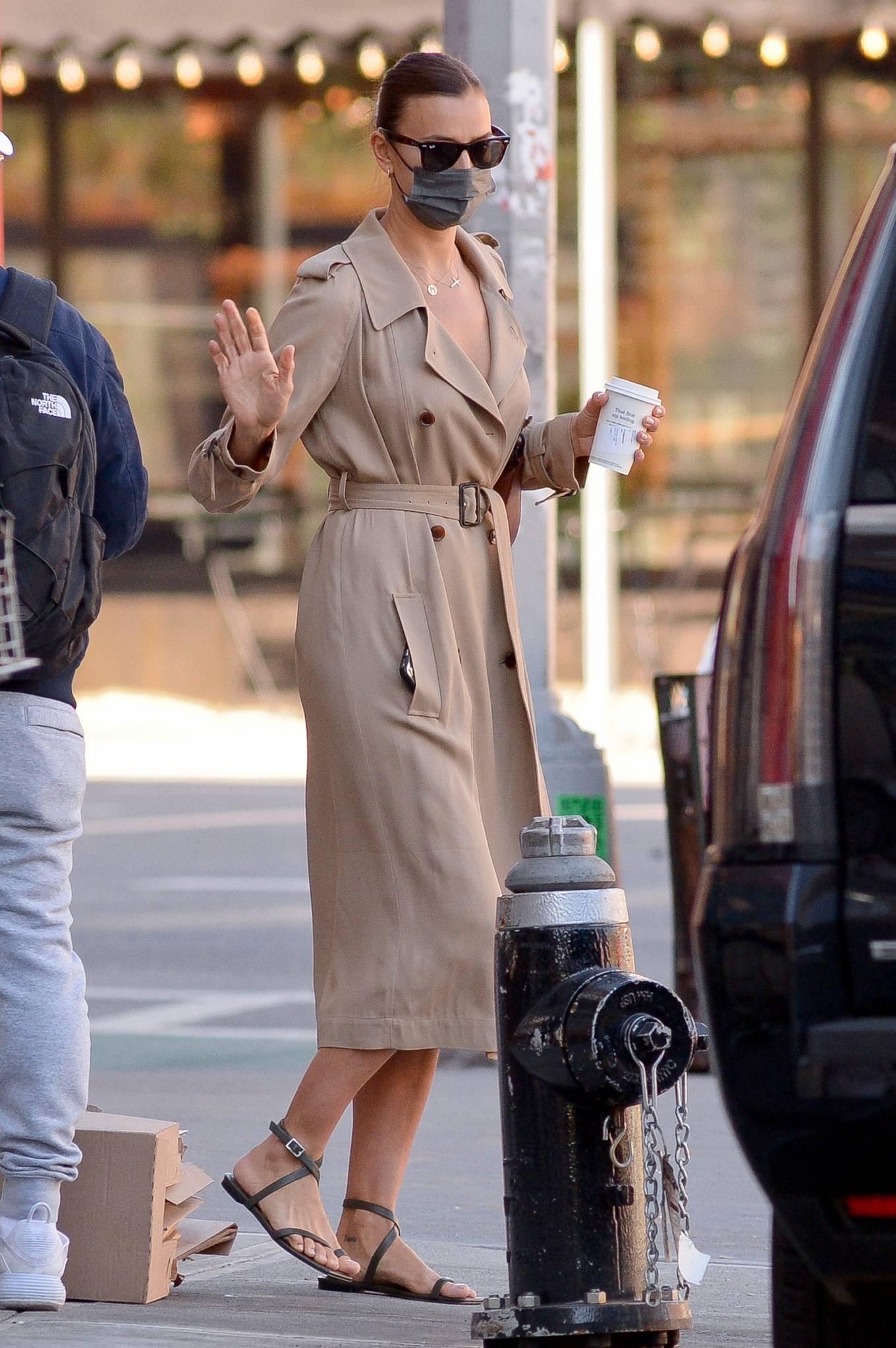 Irina Shayk - Wearing a camel trench coat in New York