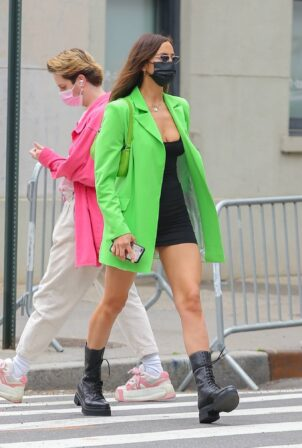 Irina Shayk - Wearing a lime green blazer over a mini dress