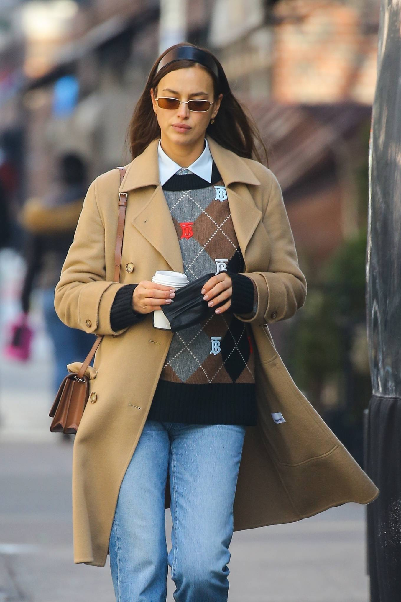 Irina Shayk - Wears a Burberry bag and sweater running errands in New York