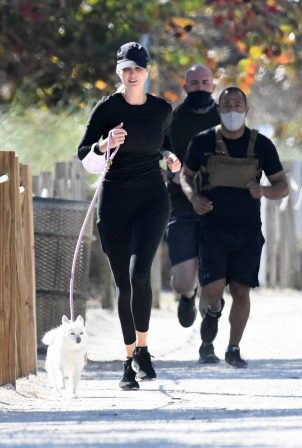 Ivanka Trump - Jog at the beach with her dog in Miami