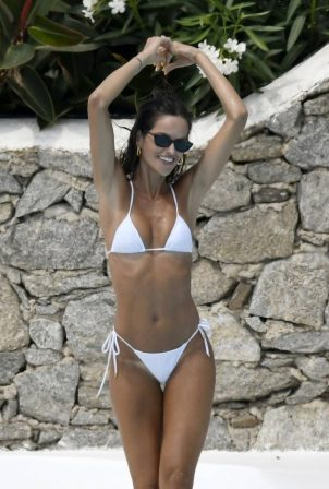 Izabel Goulart - In a white bikini poolside in Mykonos