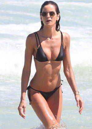 Izabel Goulart in Black Bikini at the beach in Rio de Janeiro
