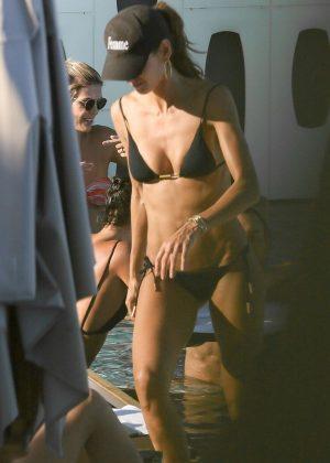 Izabel Goulart in Black Bikini on the pool in Rio