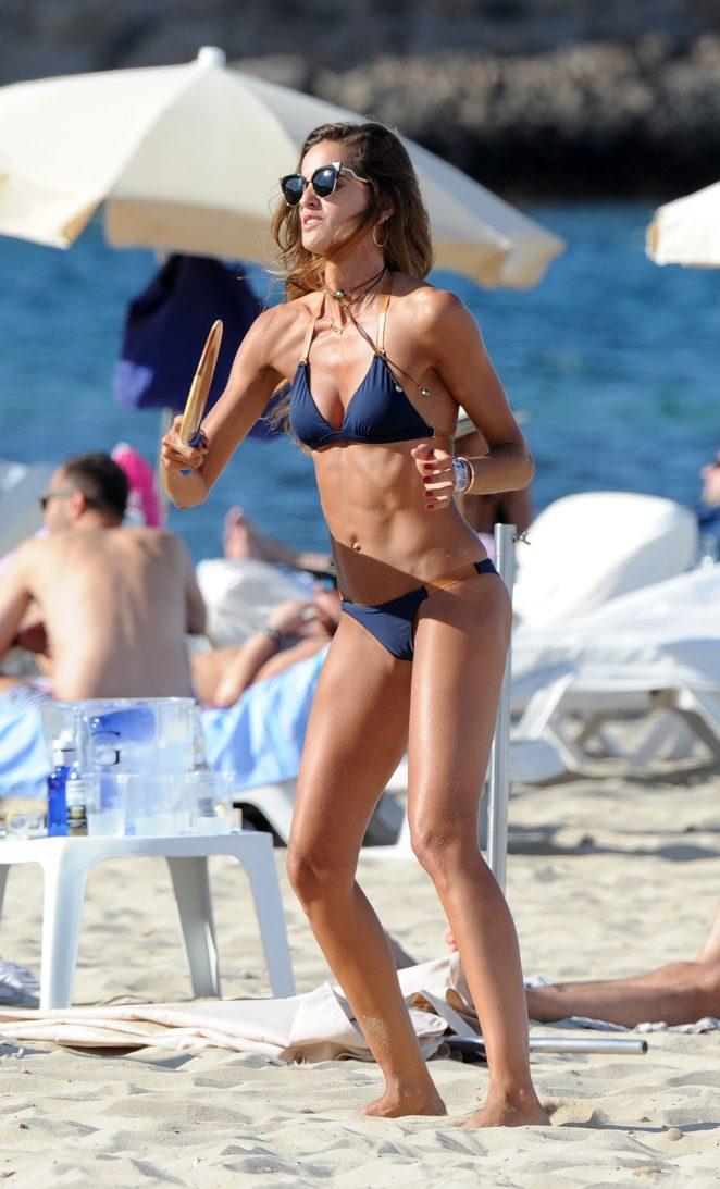 Izabel Goulart in Blue Bikini on the beach in Ibiza