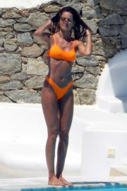 Izabel Goulart in Orange Bikini at a pool in Mykonos