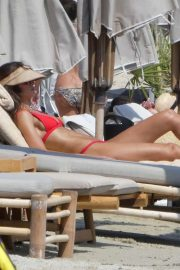 Izabel Goulart in Red Bikini at the beach in Mykonos