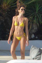 Izabel Goulart in Yellow Bikini at a pool in Mykonos