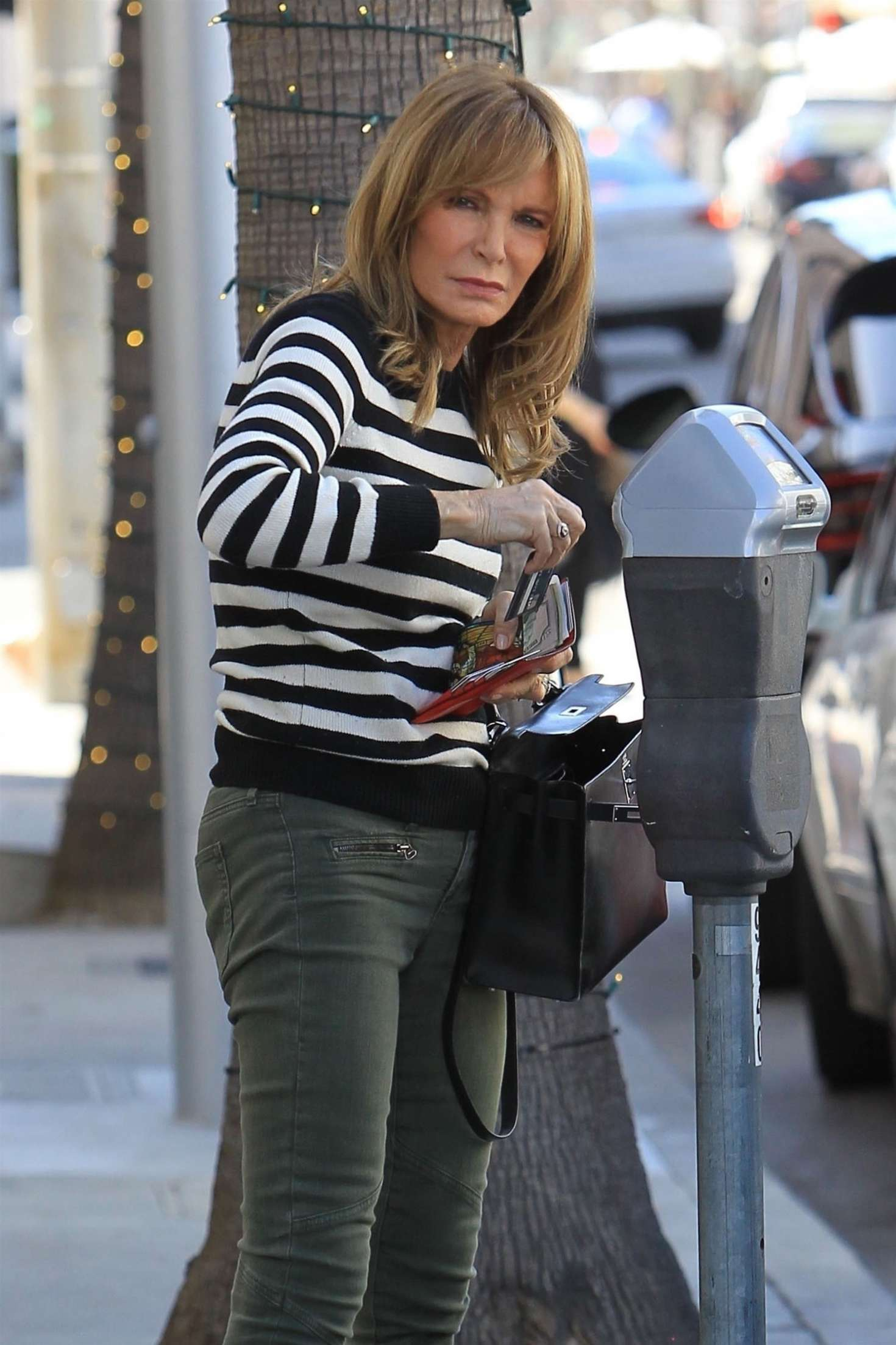 1724b1ee8a Jaclyn Smith pay her parking meter in Beverly Hills