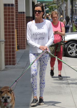 Janice Dickinson walking her two dogs in Beverly Hills