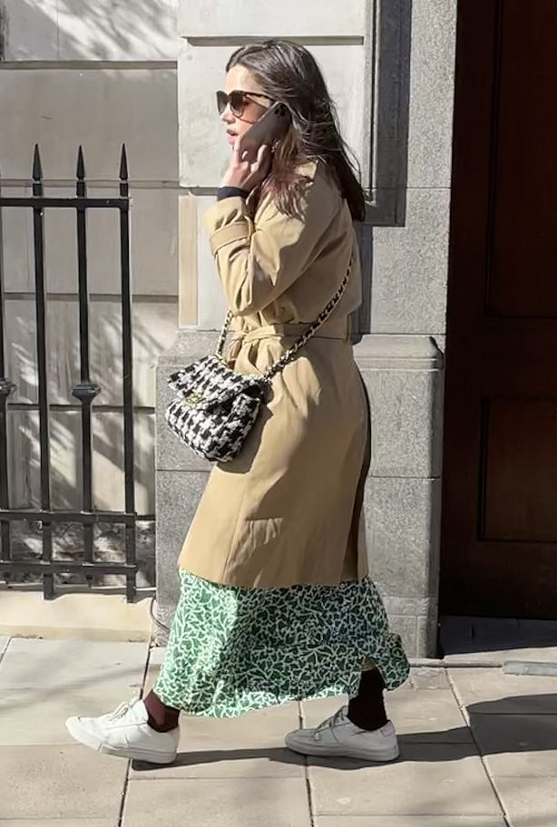 Jenna Coleman - Wearing Burberry mac, green and white pattern dres in London