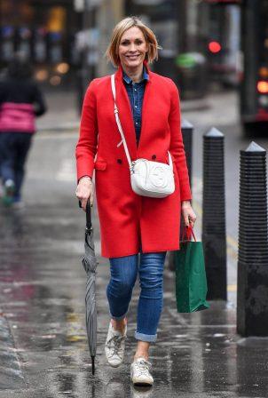 Jenni Falconer - In red coat at leaving Global Radio in London