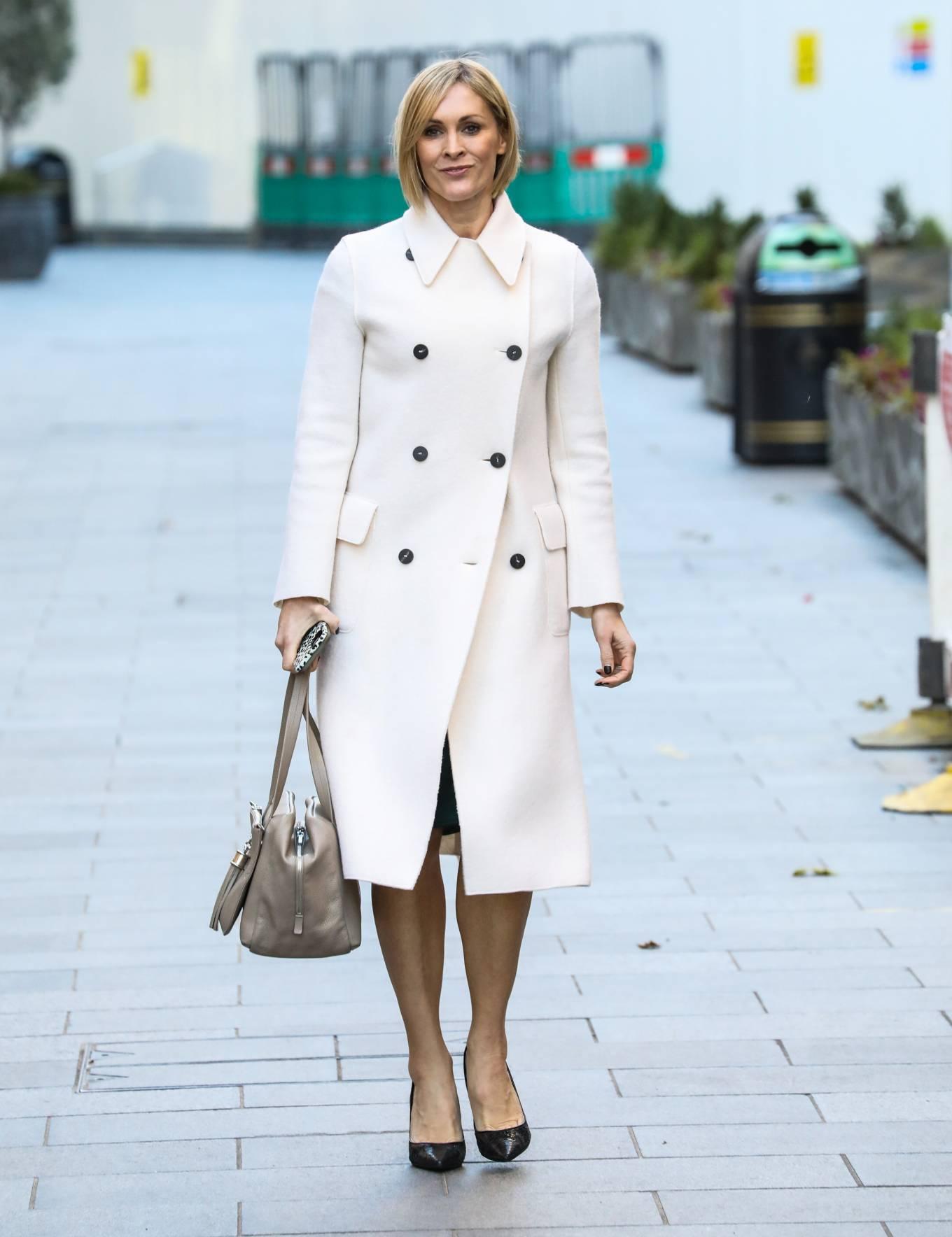 Jenni Falconer -In white coat departing the Global Radio Studios in London