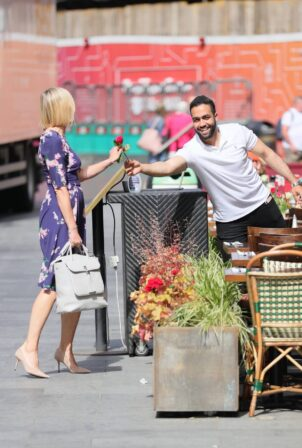 Jenni Falconer - Receives a red rose from a waiter at Smooth radio in London