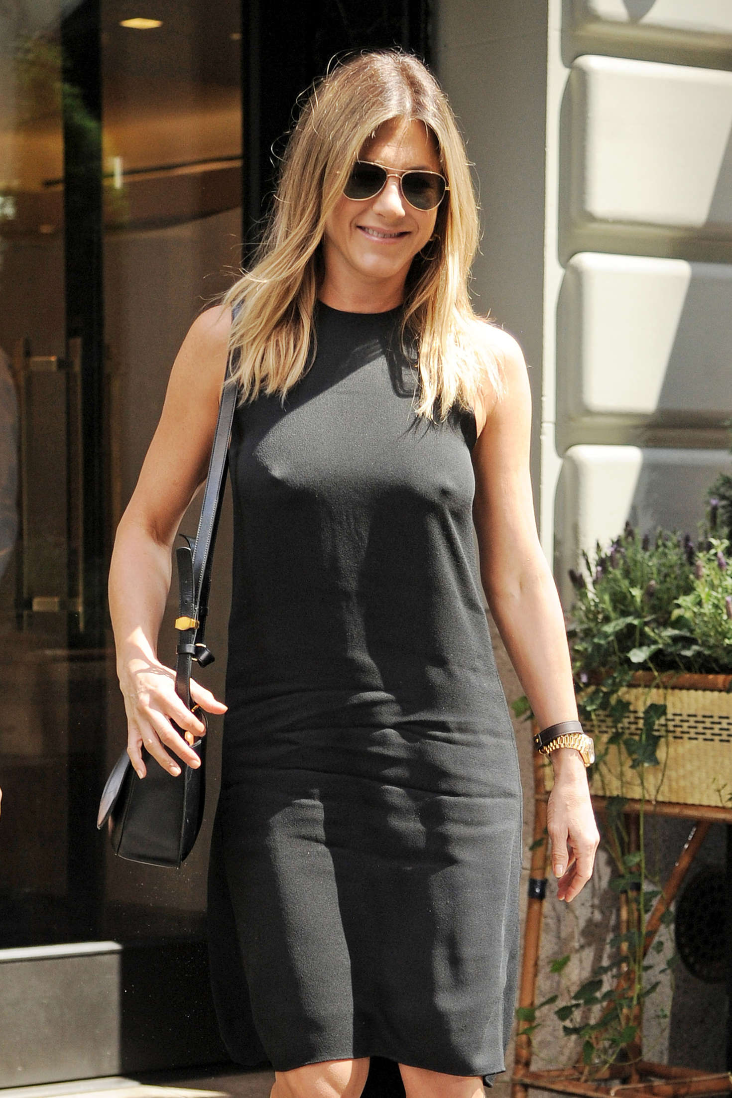 Jennifer Aniston in Black Mini Dress Out in NYC