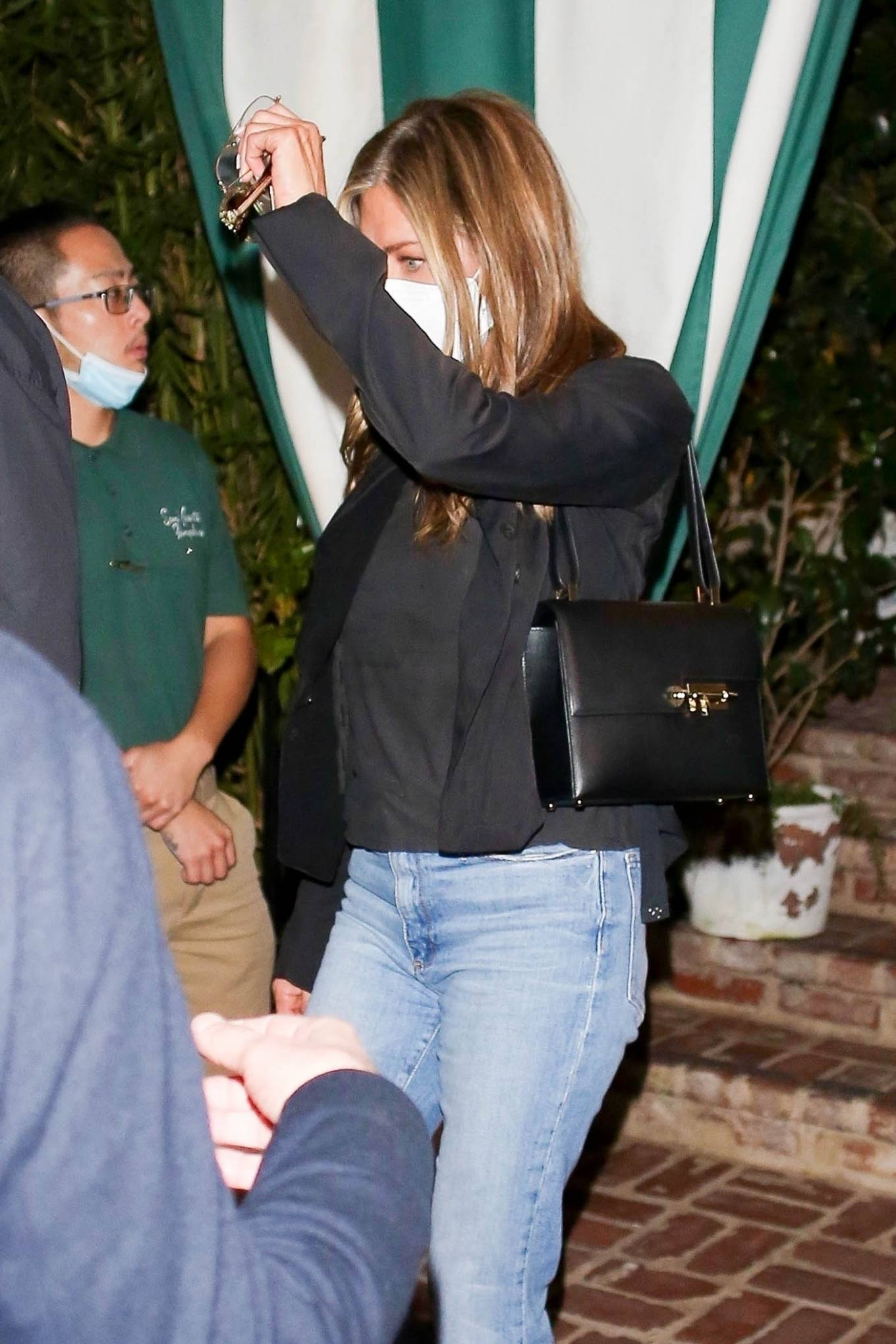 Jennifer Aniston - leaving a late dinner with friends at San Vicente Bungalows in West Hollywood