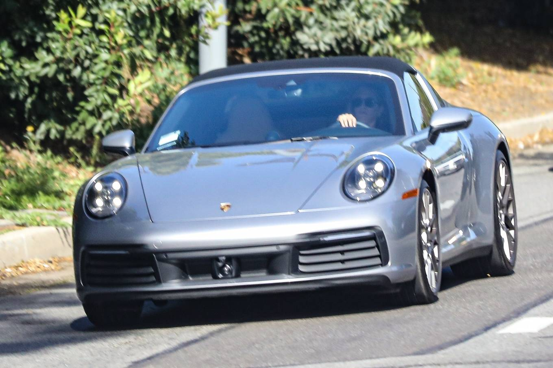 Jennifer Aniston - Seen at her Porsche 911 Targa after a pilates class in West Hollywood