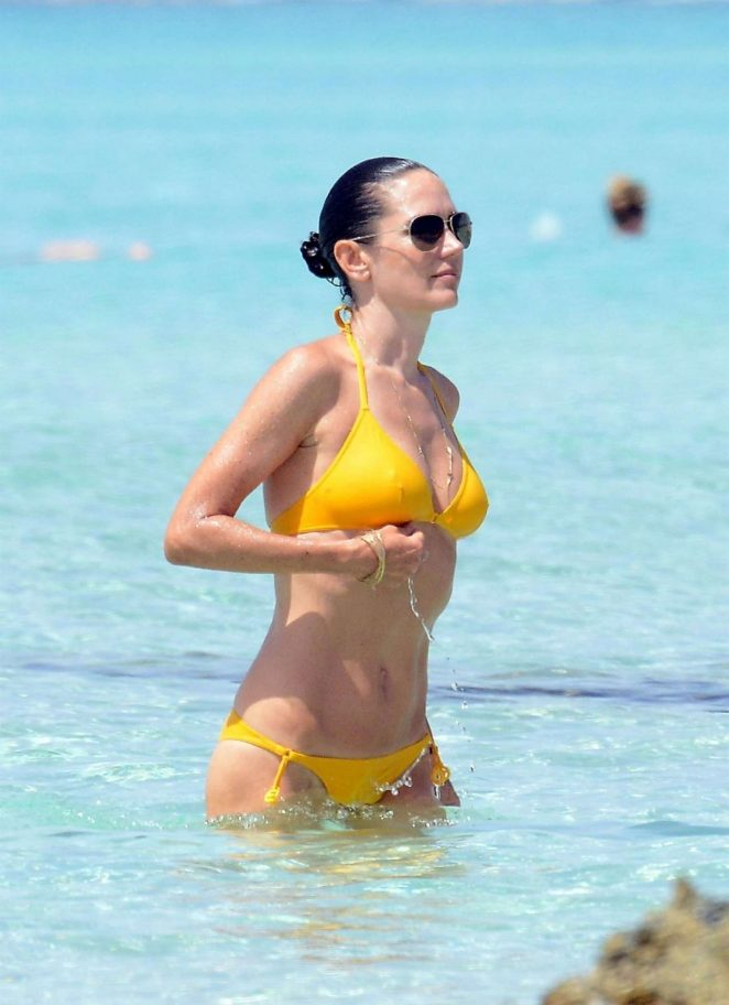 Jennifer Connelly in Yellow Bikini at a Beach in Ibiza
