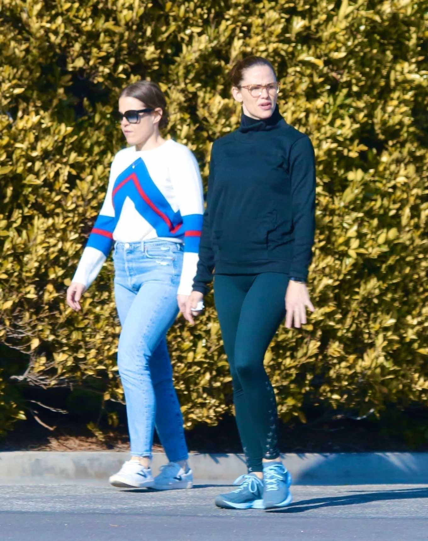 Jennifer Garner with a friend out for a power walk session in Pacific Palisades