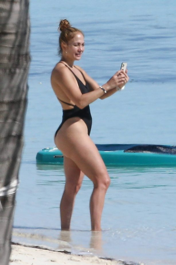 Jennifer Lopez - In a bikini paddle-boarding on the beach in Turks and Caicos