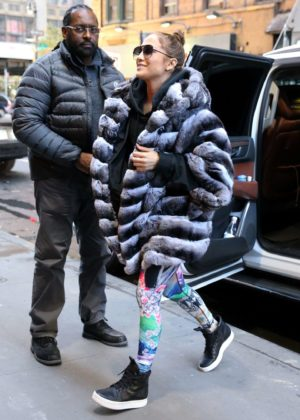 Jennifer Lopez in a faux fur coat - Arrives at the gym in New York City