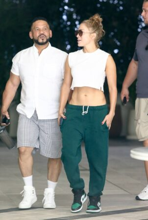 Jennifer Lopez - shows her abs while out with her manager Benny Medina in Miami