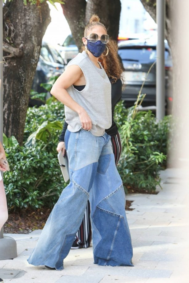 Jennifer Lopez - Waits on line at GUCCI in Miami