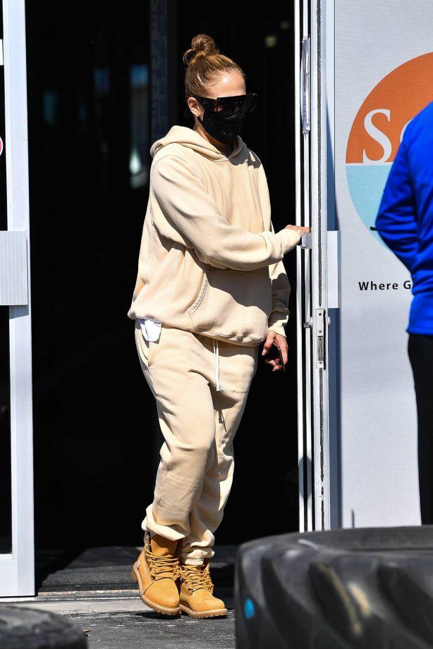 Jennifer Lopez - Wearing a beige sweat outfit in Miami