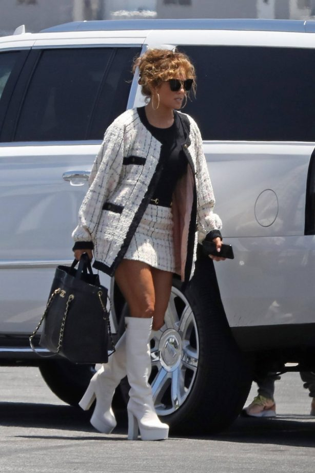 Jennifer Lopez - Wearing mini skirt and knee boots with Alex Rodriguez in Van Nuys