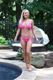 Jenny McCarthy in Pink Bikini on the pool in Los Angeles adds