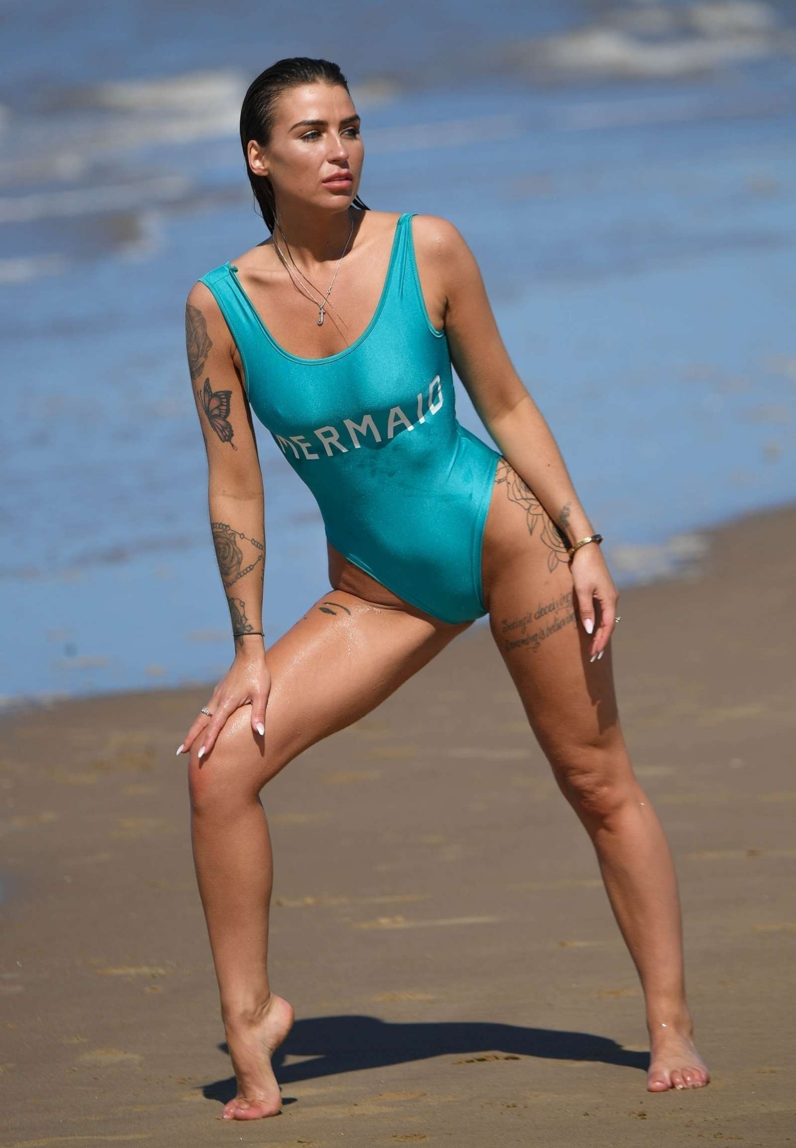 Jenny Thompson in Blue Swimsuit on the beach in Spain