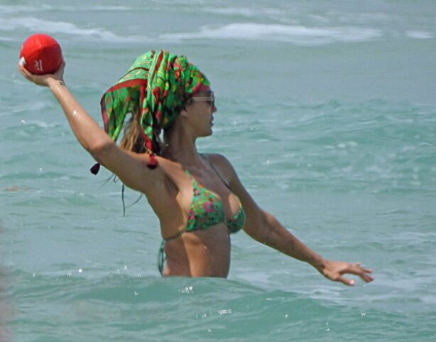 Jessica Alba - In green bikini with husband Cash Warren in Miami